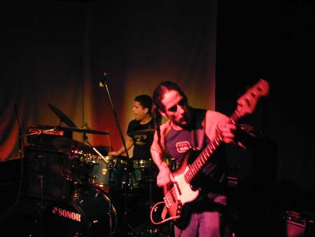 Kerry and Kevin playing live in San Francisco. Kevin in the foreground and Kerry in the background under red light